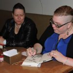 Signing a book for one of the ladies from the Toronto lesbian meetup group who came.