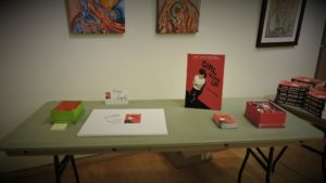 The canvas-signing table